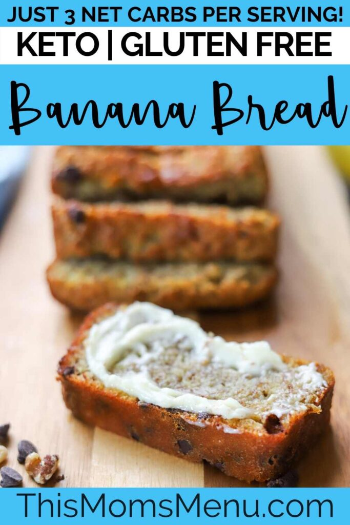 A loaf of gluten free banana bread on a cutting board with one sliced smeared with butter.