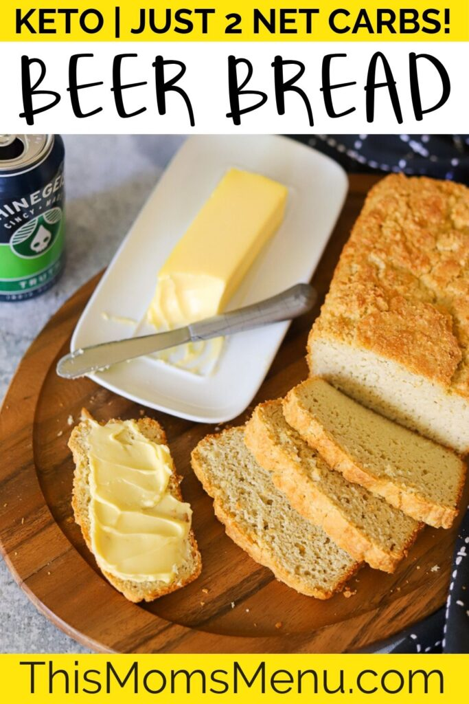 Keto bread sliced on a wooden board with a can of beer and butter in the background with text overlay