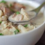 a white bowl full of keto clam chowder