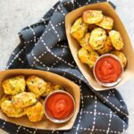 2 paper bowls full of keto tater tots with ketchup on the side