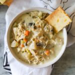 low carb creamy chicken soup in a bowl with a cracker on the side