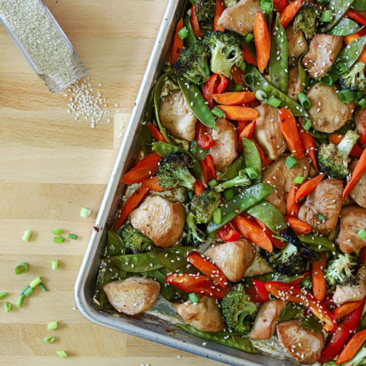 asian vegetables and chicken stir fry cooked on a sheet pan