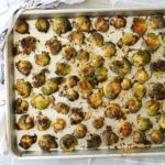 roasted and smashed brussels sprouts on a sheet pan