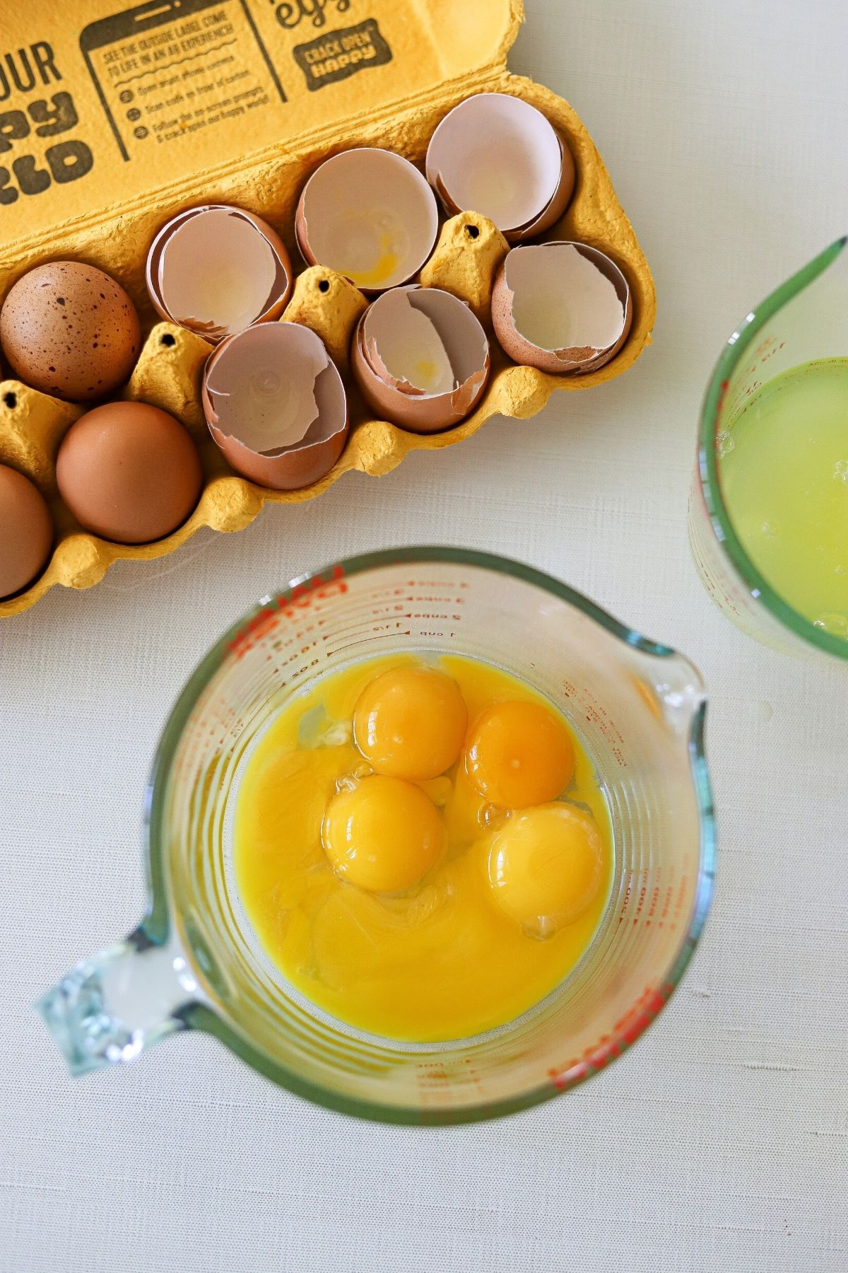 Egg yolks and whites separated into 2 measuring cups