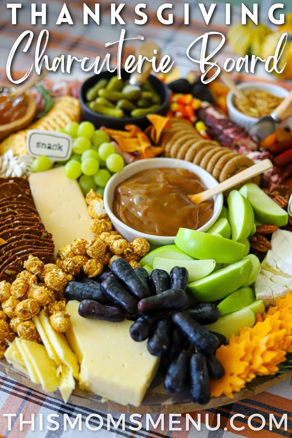 a thanksgiving themed charcuterie board with text overlay