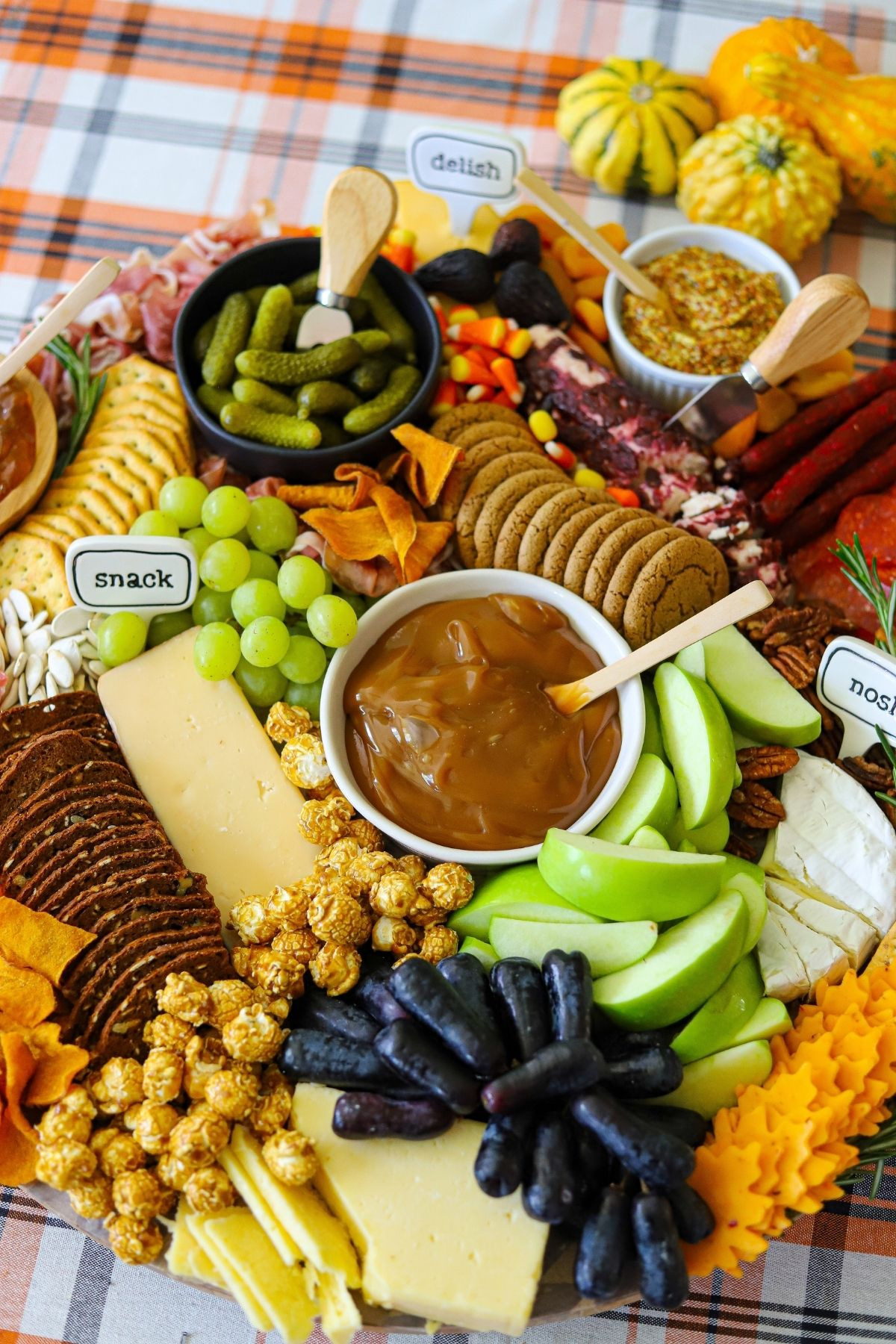 A large charcuterie board full of fall flavors