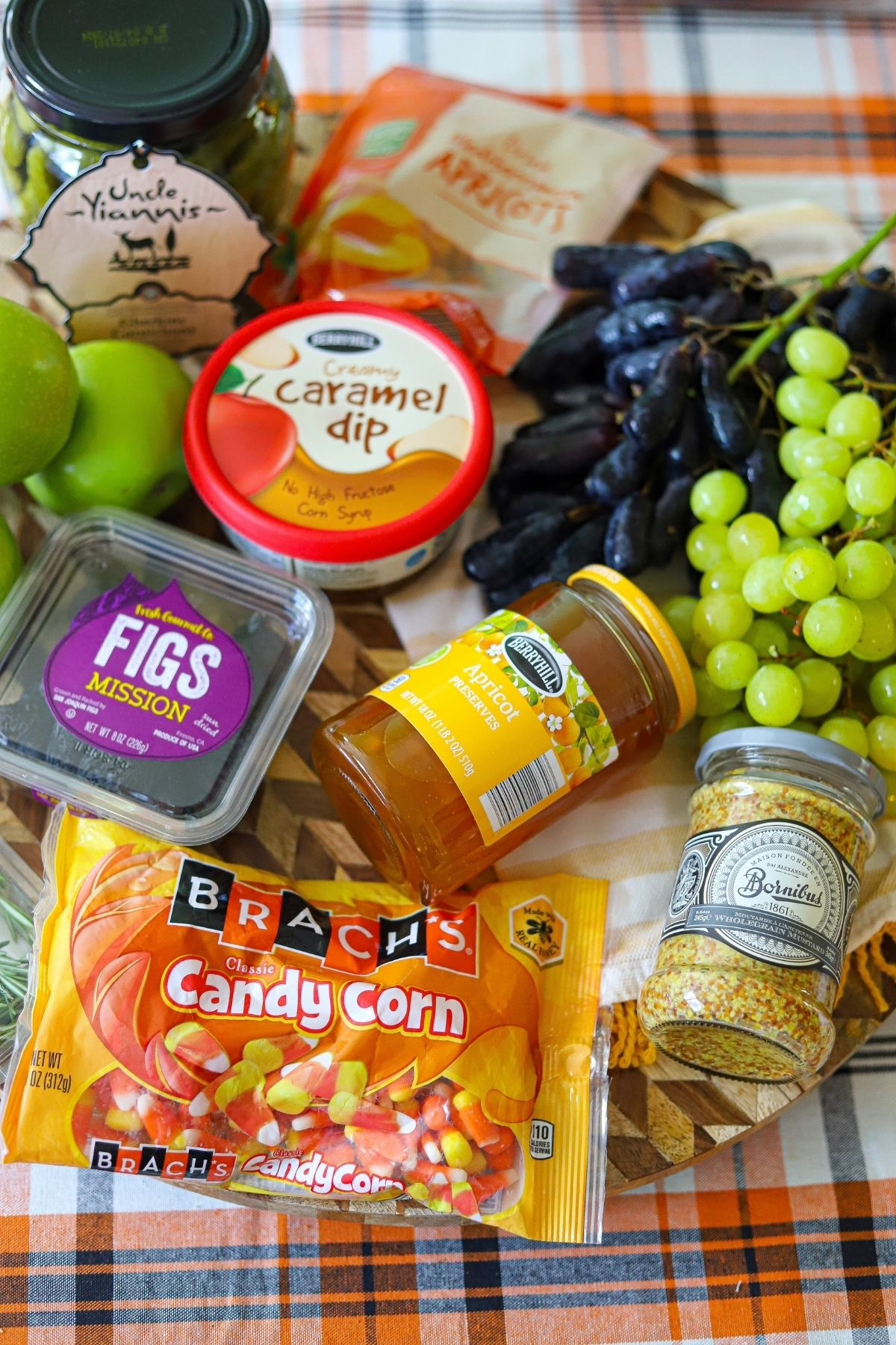fruits, jams, and other items to use on a thanksgiving charcuterie board.