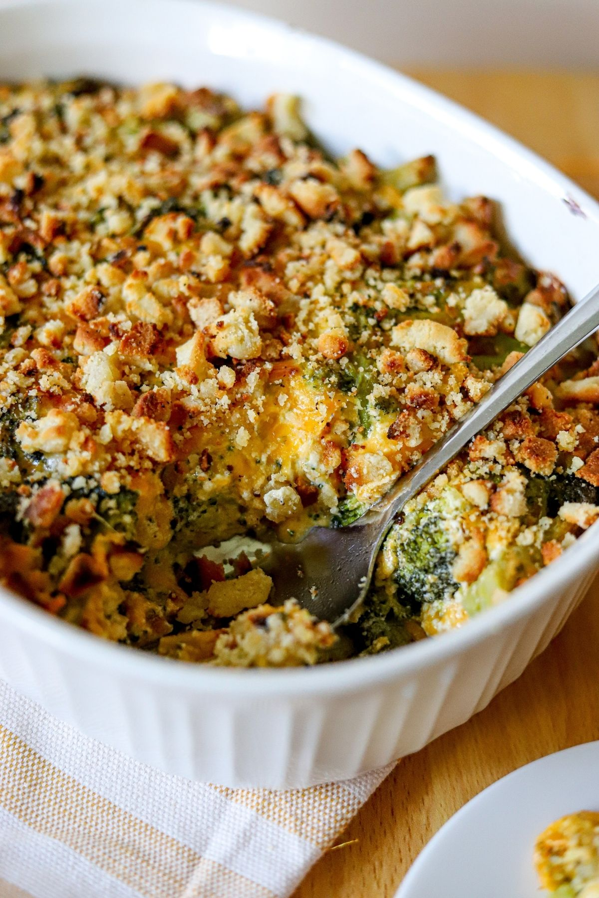A low carb broccoli and cheese casserole baked in a white dish
