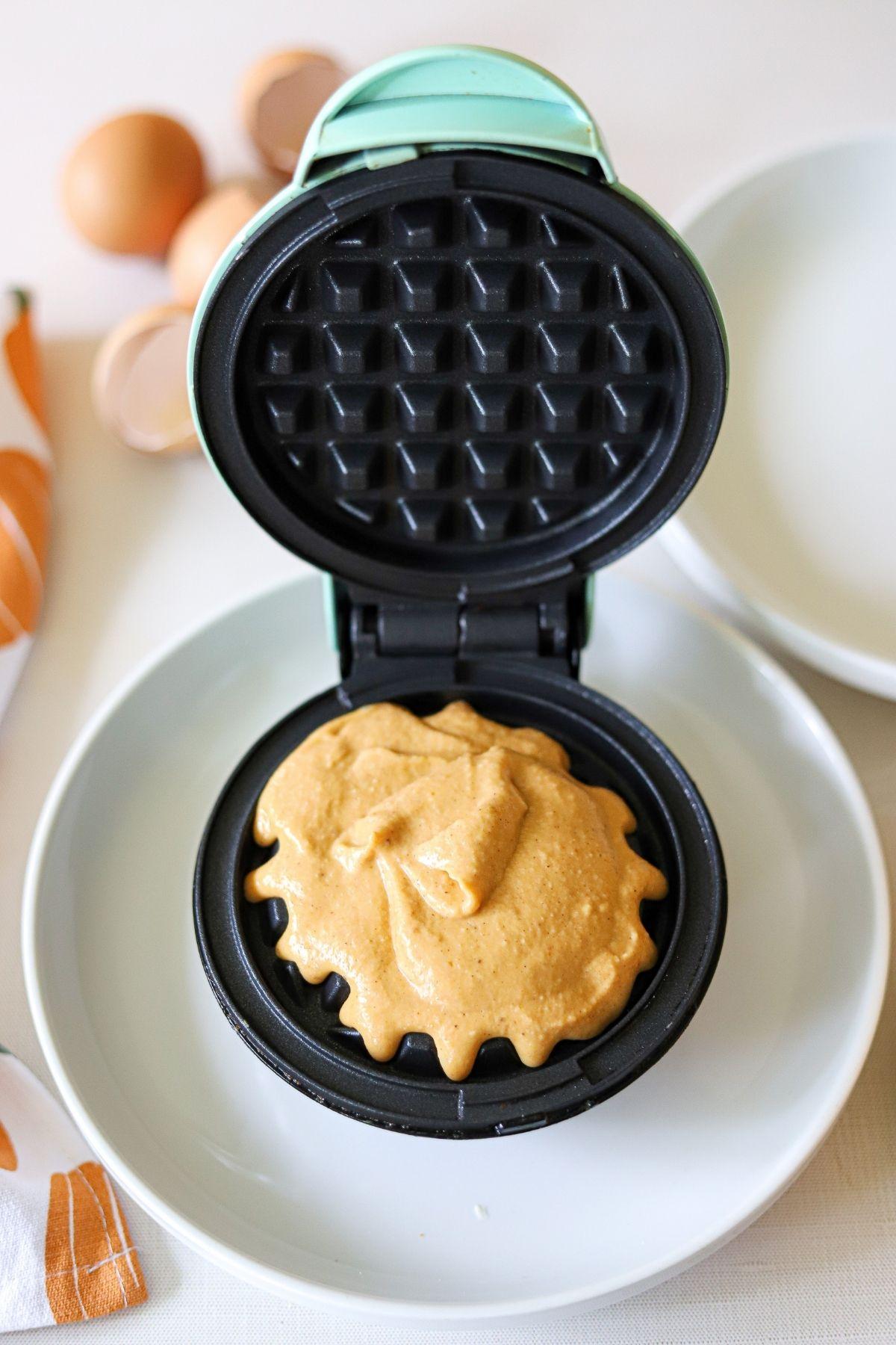 Pumpkin waffle batter in a mini waffle maker
